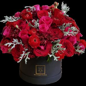 Caja de rosas rojas redonda
