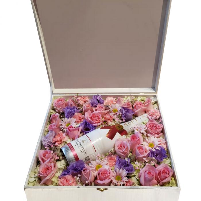 Caja de flores y champagne